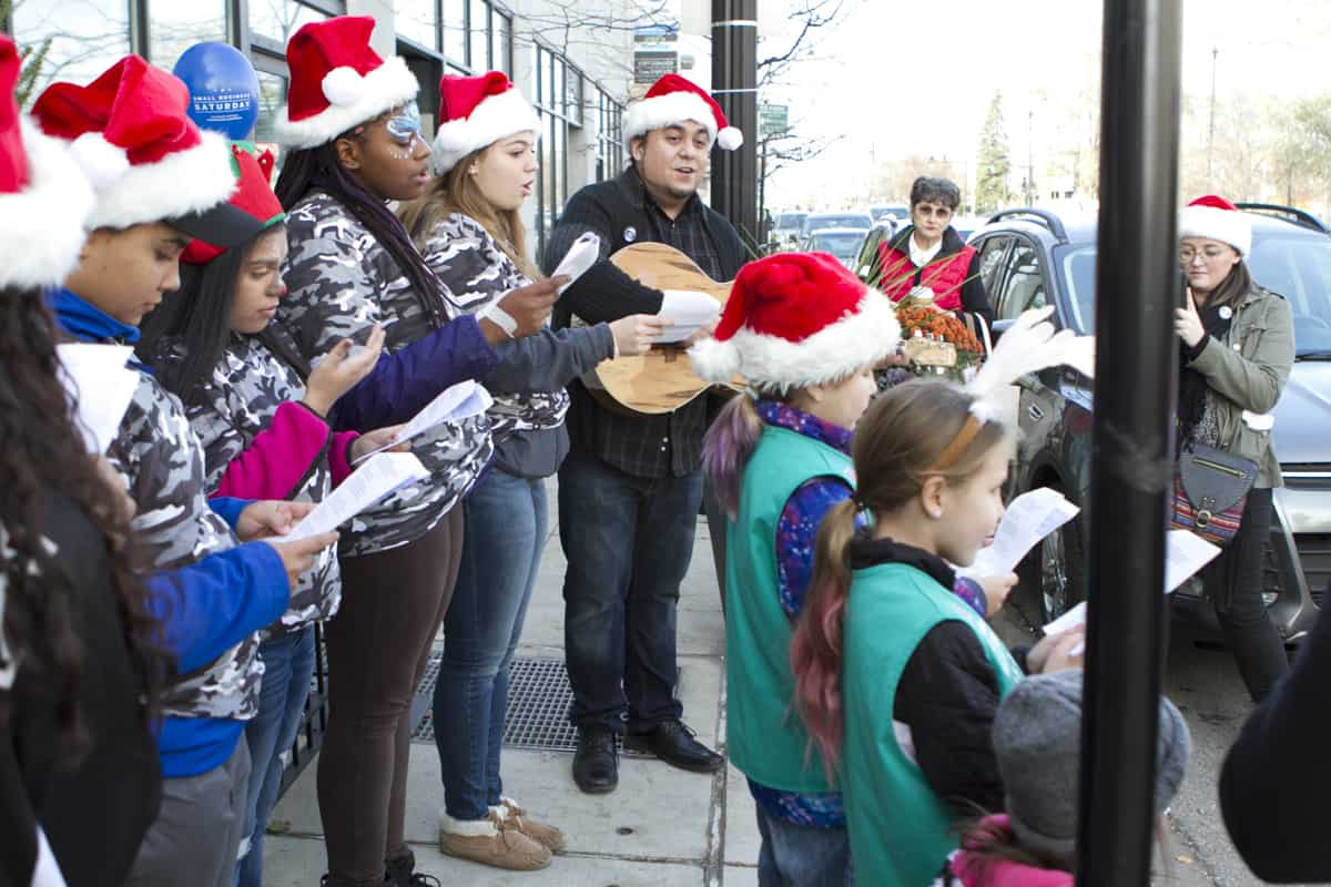 Caroling by Girl Scouts and Dale Tippett Jr at City Newsstand 2016